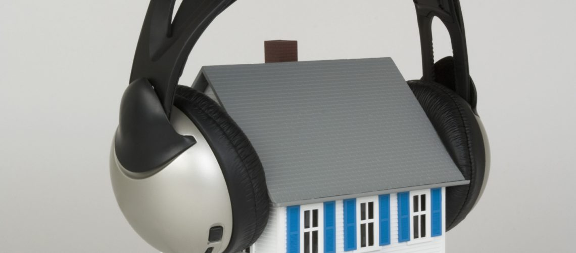 Miniature house and headphones